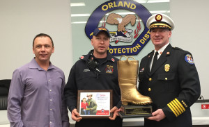 OFPD President Jim Hickey (left) joins Engineer Robert Griffin (center) and Fire Chief Ken Brucki in accepting the Golden Boot Award for raising a record $25,000 to fight Muscular Dystrophy. (Photo courtesy OFPD)