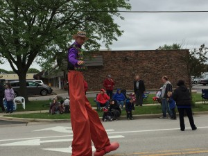 Man on stilts walking the entire length of the parade. That's not easy!