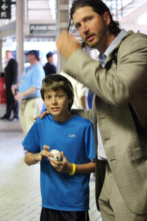 Aaron Hanania getting a baseball autograph at Wrigley Field