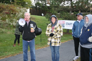 Orland Park Mayor Dan McLaughlin using a megaphone addressing the large turnout of supporters at today's Walk. Bridge Teen Center co-founder Priscilla Steinmetz also pictured alongside Mayor McLaughlin. Photos Copyright (C) 2015 Steve Neuhaus. All Rights Reserved