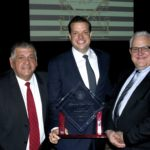 Lyons Village President Christopher Getty was named 2016 Man of the Year by the Illinois State Crime Commission for his efforts in passing the local Gun legislation which has become the basis for the Intergovernmental Agreement (IGA) on guns sales between Lyons and Cook County government. Picture (from left) Lyons Trustee Greg Ramirez, Lyons Village President Christopher Getty, and Lyons Trustee Dan Hilker. Photo courtesy Village of Lyons.
